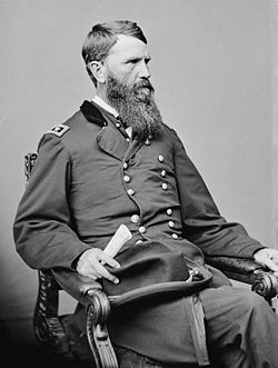 Seated man with beard in uniform