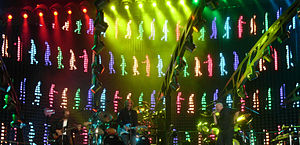 """Turn It On Again: The Tour - A sample of the multi-million pound video screen/light show during """"I Can't Dance""""."""