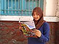 Girl reading Panjebar Semangat.jpg