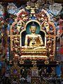 Golden statues of Gautama Buddha at Bylakuppe.jpg