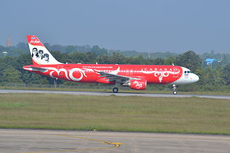 Carabao (band) - A Thai AirAsia Airbus A320 in a livery celebrating the bands 30th anniversary, seen here at Khon Kaen Airport in October 2013.