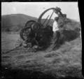 Hay baler at Silverstream, 1923. ATLIB 300310.png