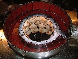 Hujiao bing - Hújiāo bǐng being baked in an oven.