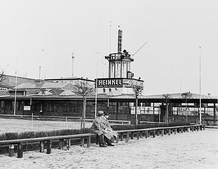 The airport in 1937, at the 1927-built terminal building. Heinkel at Tempelhof Airport in Berlin, Germany 1937.jpg