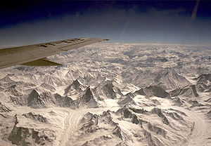 A photo of Himalayan mountains from air.
