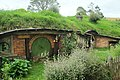 Hobbit hole with green door.jpg