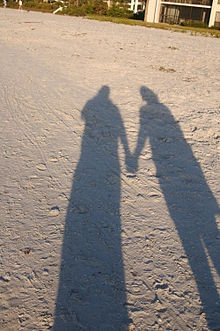Holding Hands shadow on sand.jpg