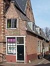 foto van Eenvoudige kosterswoning tegen zuiderbeuk van de Noorderkerk