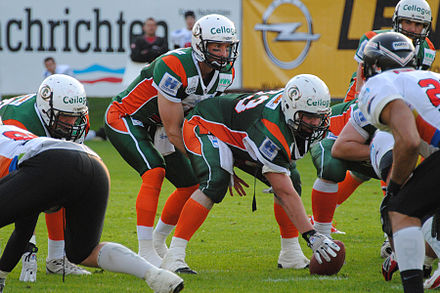A quarterback for the Kiel Baltic Hurricanes under center, ready to take the snap Hurricanes Quarterback.JPG