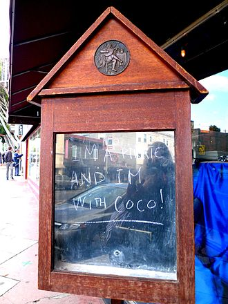 """826 Valencia - The storefront for 826 Valencia's pirate supply store with a sign reading """"I'm a pirate and I'm with Coco!"""""""