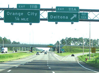Exit numbers in the United States - Mile-based exit numbers on Interstate 4 in Volusia County, Florida circa 2003. In this case, mile-based exits 111A and 111B had been sequential exits 53CA and 53CB, as the 'OLD 53CA' tab shows. The 'OLD 53CA' tabs have been removed and the signs now solely use the mileage based exits.