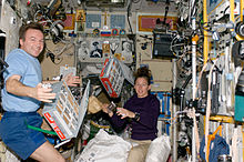 ISS-18 Sandra Magnus and Yuri Lonchakov with food storage containers in the Zvezda Service Module.jpg