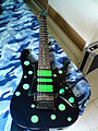 Ibanez Universe UV7BK with green dots.jpg