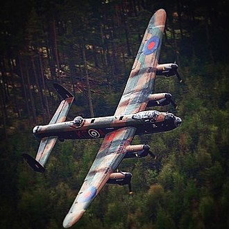 Operation Robinson - A Lancaster pulls up over the tree-tops