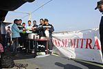 Indian Navy officers serve meals on deck to evacuees (02).JPG