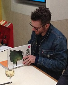 Jamie Hewlett in 2014 signing copies of