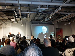John Pilger - John Pilger, Richard Gizbert, and Julian Assange – 'The WikiLeaks Files' Book Launch – Foyles, London, 29 September 2015