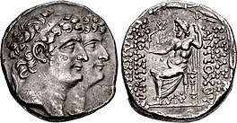 Coin minted by Antiochus XI and Philip I. The obverse depict them together with Antiochus XI appearing ahead of Philip. The reverse contain the kings' names to the right and their epithets to the left. In the middle of the reverse, Zeus is depicted sitting on a throne holding a sceptre and holding a Nike in his hand which is stretched toward the inscription of the epithets