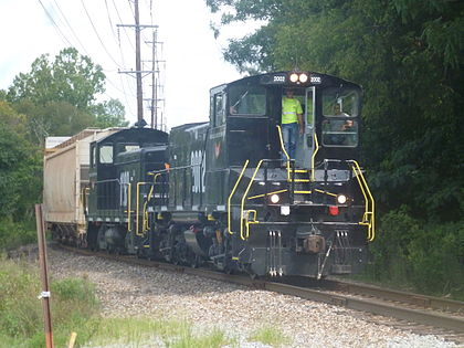 Knoxville and Holston River Railroad MP15AC #2002 leads a train through Tyson Park near downtown Knoxville. KXHRLOCAL1.jpg