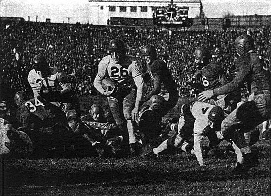 Ben Kish (26) is sprung by a Ted Konestsky (31) block in a 1938 34-7 Pitt romp over Southern Methodist at Pitt Stadium KishPittvsSMUOwl39p277.jpg