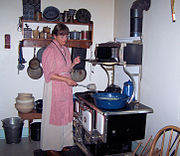A park interpreter demonstrates a typical rural American kitchen of 1918 at The Sauer-Beckmann Farmstead, a living history farm in Texas.