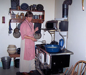 Lyndon B. Johnson State Park and Historic Site - A park interpreter demonstrates a typical rural kitchen of 1918 at the Sauer-Beckmann Farmstead.