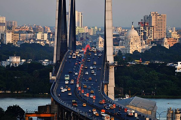 Aerial view of the Kolkata skyline, including the Victoria Memorial and Vidyasagar Setu. Kolkata City skyline from Hoogly bridge.jpg