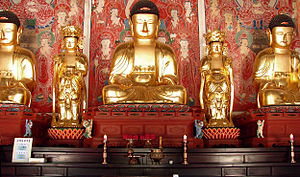 Gakhwangjeon Hall - The Buddha Sakyamuni, attended by the Bodhisattvas Samantabhadra (left) and Manjusri (right), forming the Buddhas of the Three Periods with Prabhutaratna (far left) and Amitābha (far right).
