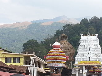 Kukke Subramanya Temple - View of the temple with temple car in foreground and Kumar Parvatha in the background