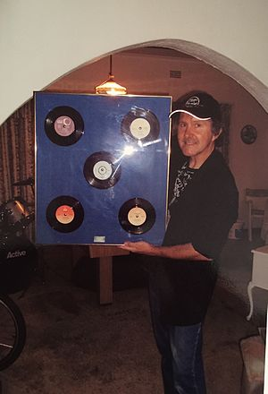 Leigh Ashton - Leigh standing with his records