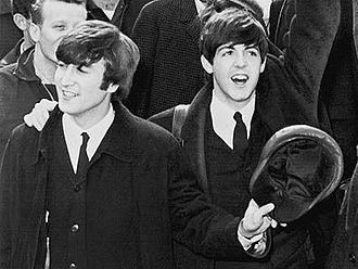 Lennon–McCartney - John Lennon (left) and Paul McCartney (right) in 1964