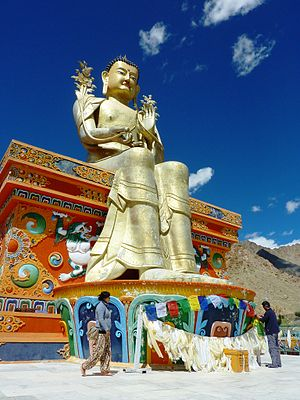 Likir Monastery - Hanging prayer flags on the 23 m (75 ft) statue of Maitreya