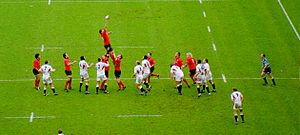 Line-out (rugby union) - Wales (red) win a lineout against England in the 2004 Six Nations Championship. England have chosen not to compete for the ball in the air, but are ready to drive into the ball carrier when he lands.