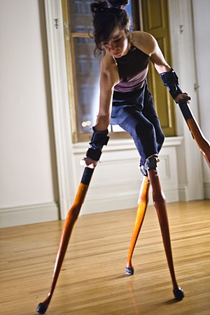 Disability in the arts - Lisa Bufano performing on her signature orange Queen Anne table legs.