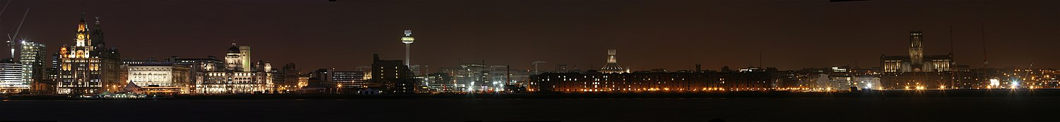 Liverpool waterfront by night, as seen from the Wirral, is a UNESCO World Heritage site