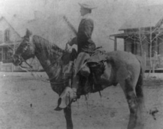 "Cornelius C. Smith - Smith poses with his favorite horse ""Blue"" in front of his quarters at Fort Wingate in 1895."