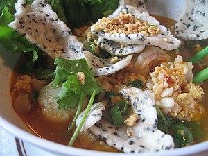 Bánh tráng - Baked sesame banh trang topped in mi quang