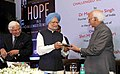 M. Hamid Ansari receiving the first copy of the Book titled 'Hope in a challenged democracy; An Indian narrative', authored by Shri Ashwini Kumar, from the former Prime Minister, Dr. Manmohan Singh, in New Delhi.jpg