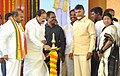 M. Venkaiah Naidu lighting the lamp to lay the foundation stone for AMRUT & PMAY, at Chilakaluripet, Andhra Pradesh.jpg