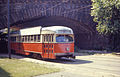 MBTA 3052 under arch on Arborway.jpg
