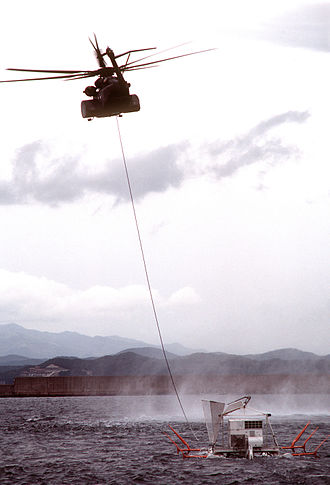 Minesweeping - An MH-53E from HM-15 tows a minesweeping sled while conducting simulated mine clearing operations