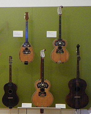 Tamburica - Tamburitza instruments displayed at permanent exhibition at The Musical Instrument Museum (MIM) Tempe, AZ 85284. Shell inlaid pear like brač and guitar like shaped brač and bugarija are made by Gilg, Sisak, Croatia. Smaller dark colored is brač made by B. Grđan, Gračani, Zagreb. The large dark colored is čelo.