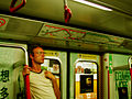 MTR people a Caucasian holding a pole.jpg