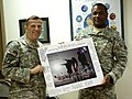 Maj. Gen. Peter Vangjel presents plaque 110702-A-AG442-022.jpg