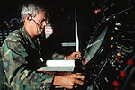 Maj. John Patrick of the 129th Tactical Control Squadron, Georgia Air National Guard, monitors a radar screen in a TPS-43 shelter during the NATO Exercise Tactical Fighter Weaponry '89 DF-ST-90-10865.jpg