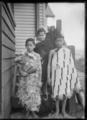 Makere Rangiatea Ralph Love, Wi Hapi Love (Jnr), and Tiwhiti Love alongside their house at Korokoro, Wellington ATLIB 287391.png