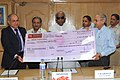 Mallikarjun Kharge receiving a cheque of maiden interim dividend amounting to Rs. 4.90 crore from the Chairman, Pipavav Railway Corporation Limited (PRCL) & Member Traffic, Railway Board.jpg