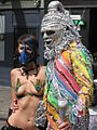Man and woman in costume at Folsom Street Fair 2012.jpg