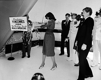 Marilyn Quayle - Marilyn Quayle christens the USS Vincennes (CG-49) by breaking a bottle of champagne on its bow during a ceremony at Ingalls Shipbuilding