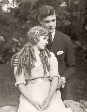 Paul Kelly (actor) - Mary Miles Minter (playing Anne Shirley) snuggles with Paul Kelly (Gilbert Blythe) in a scene still for the 1919 silent film Anne of Green Gables